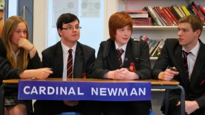 The winning Cardinal Newman team pondering their next answer.