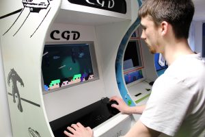 Daniel Headspith playing the game created by his team called Bottle the Band.
